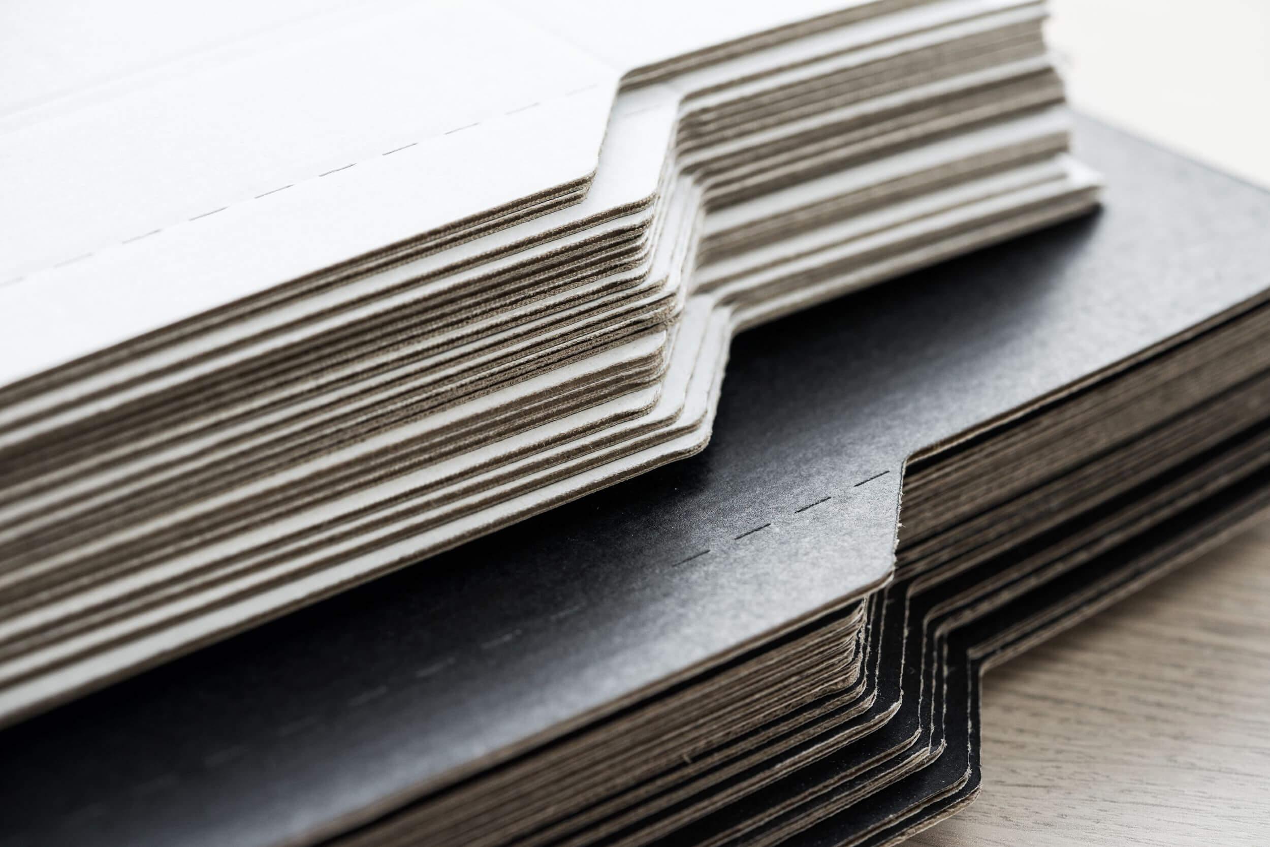 stack of cardboard packhelp