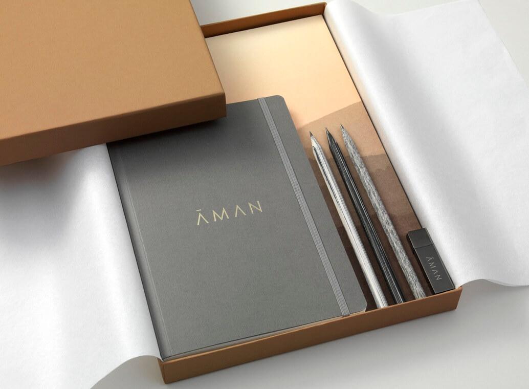 packaging para eventos que incluye una libreta y bolígrafos