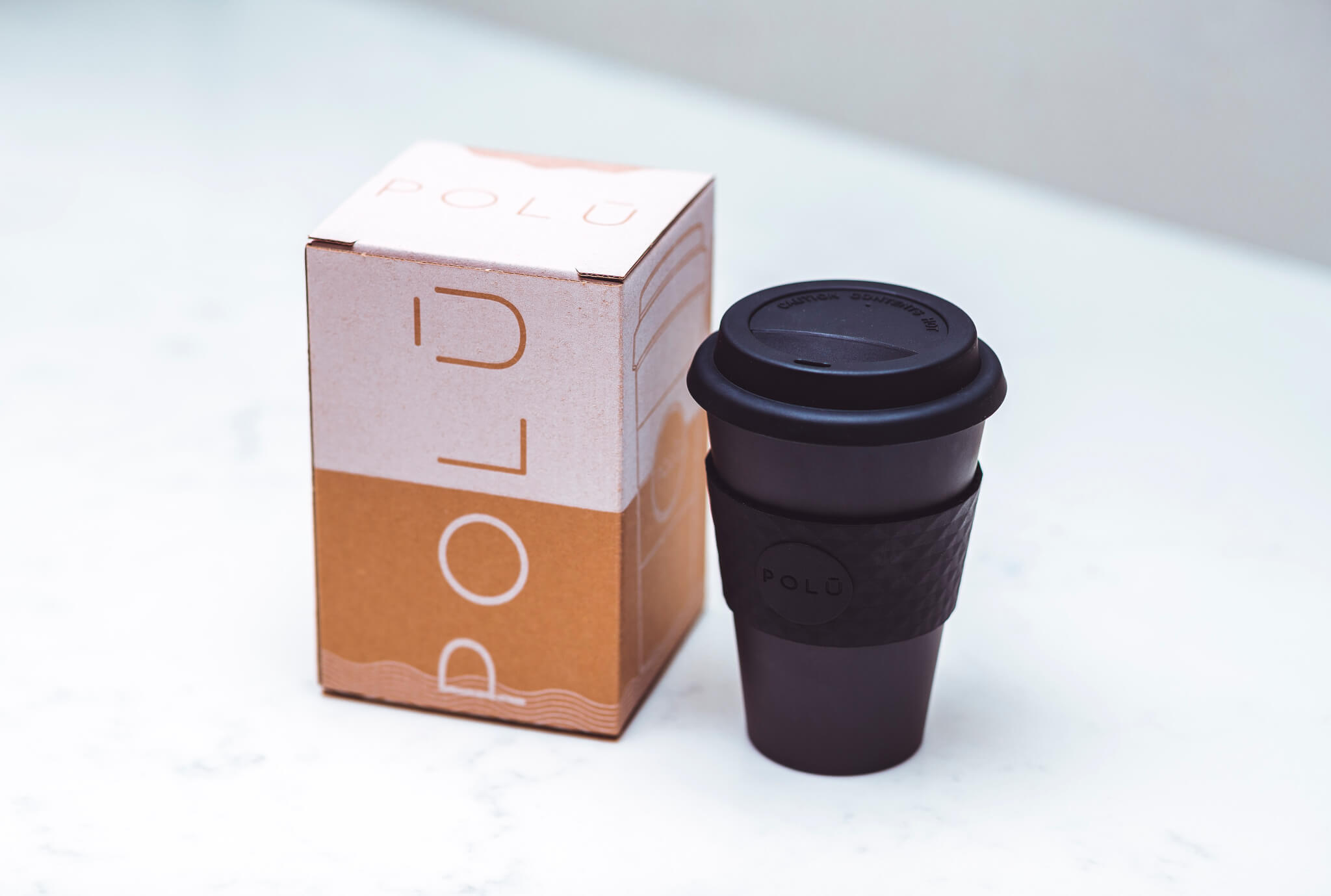 black reusable cup and packaging by polu eco products