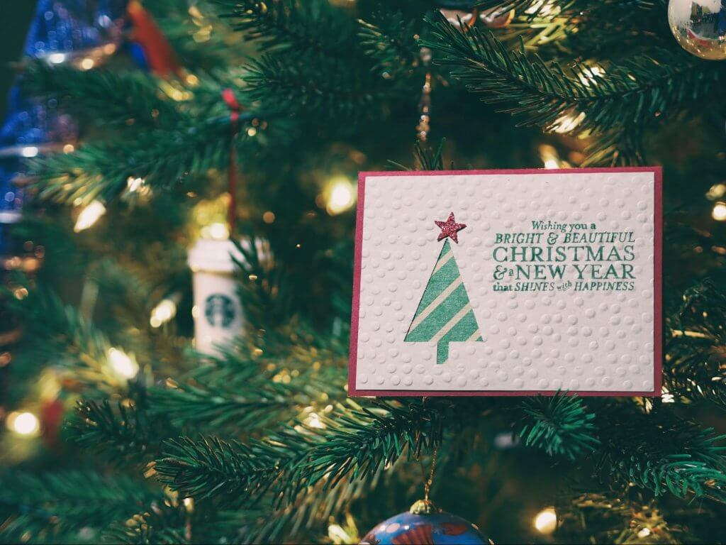 christmas card in a christmas tree