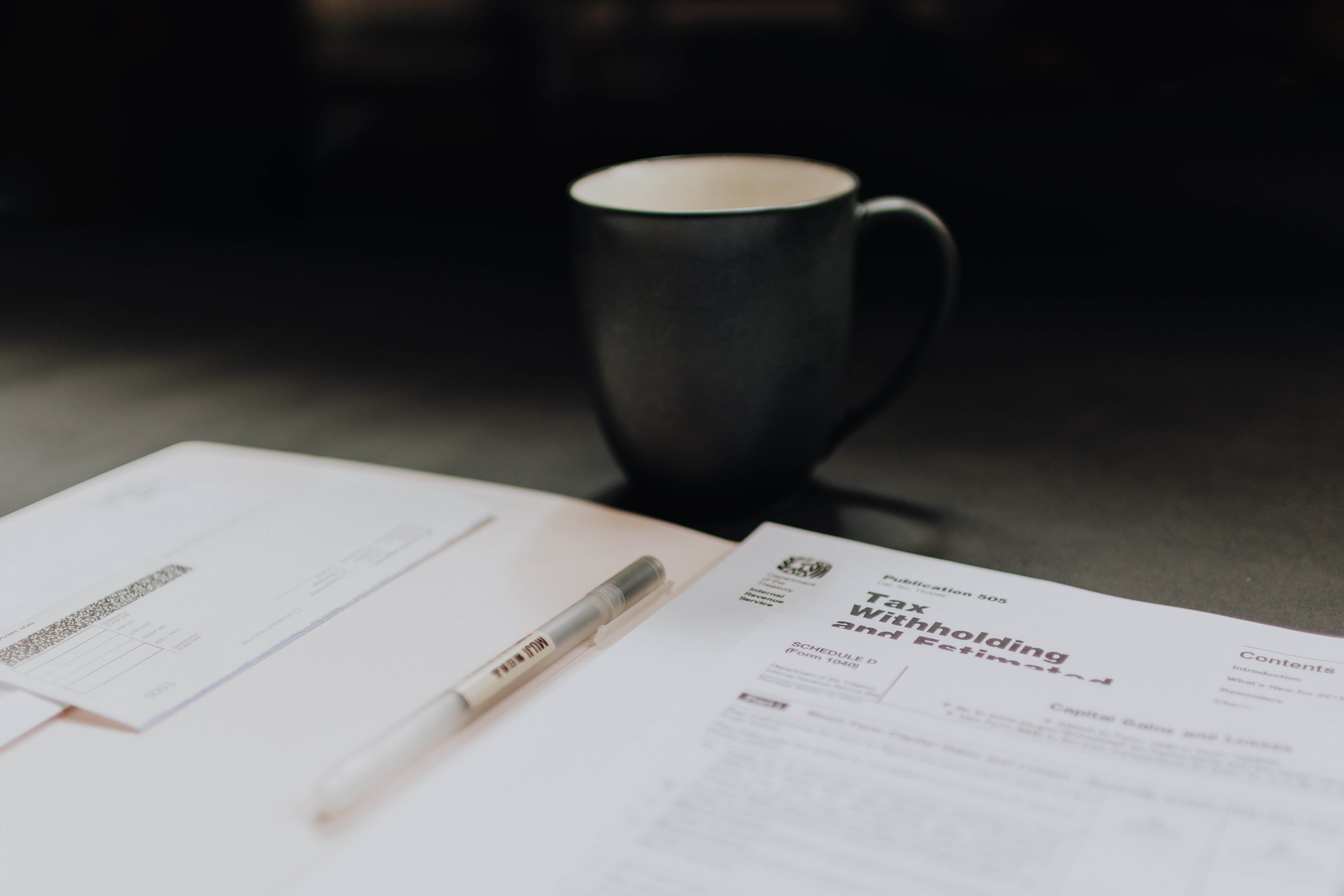 Documents and a mug