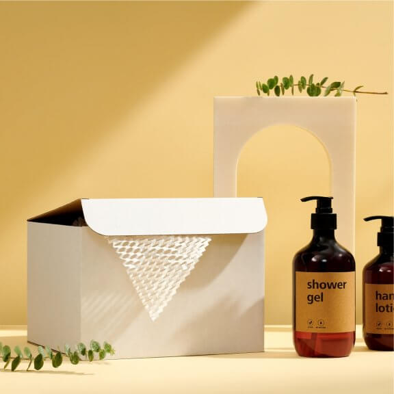 white cardboard product box with bottles of shower gel